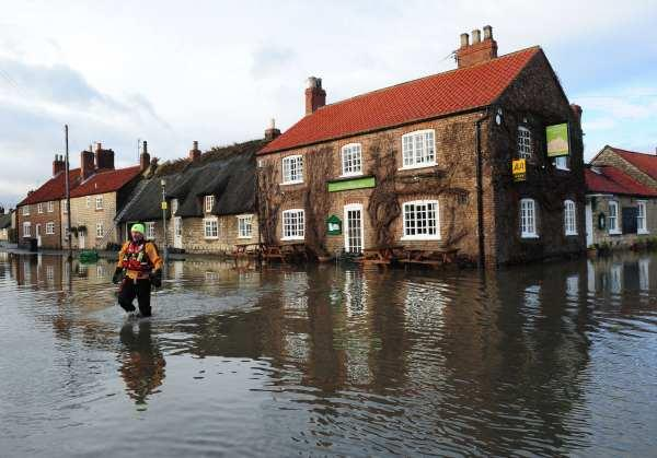 Fire fighters in the flooded streets of Old Malton, North Yorkshire, yesterday