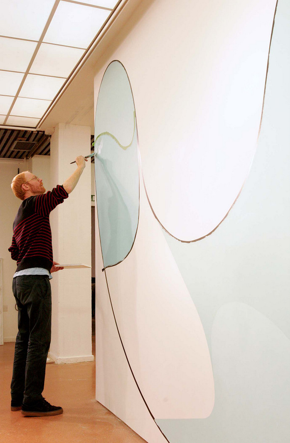 PAINTING SKILLS: Toby Paterson at work on the exhibition