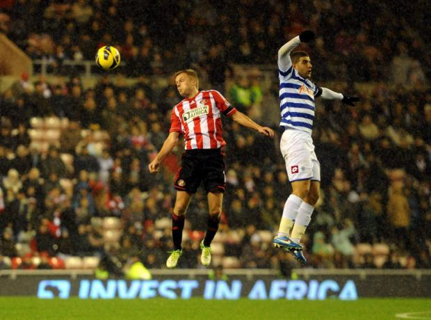 UP IN THE AIR: Seb Larsson goes up for a header with Adel Taraabt in last night's 0-0 draw at the Stadium of Light