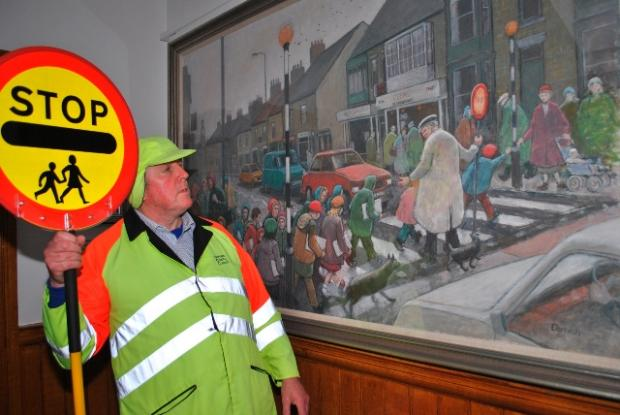 George Wright views a Norman Cornish painting depicting the crossing patrol he works in Spennymoor
