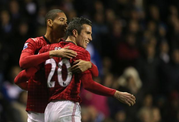 WINNING GOAL: Robin van Persie celebrates with Chris Smalling after the Dutch striker scored what turned out to be the winning goal against Reading on Saturday
