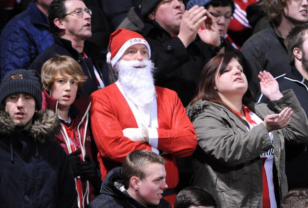 The Northern Echo: CHRISTMAS CHEER? Santa Claus was among the Sunderland supporters at Carrow Road, but he didn't look happy