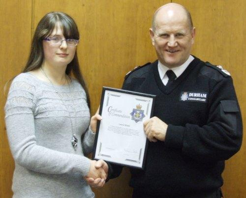 WELL DONE: Laura Dean receiving her award from Mike Barton