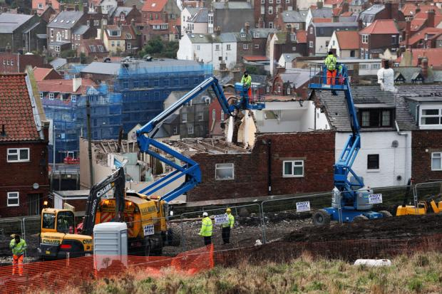COMING DOWN: The houses in Aelfleda Terrace are demolished