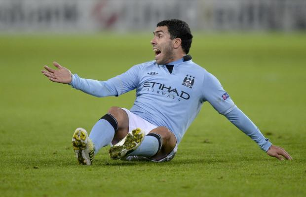 MANCHESTER CITY'S Carlos Tevez reacts to a decision against his team as the English Premier League champions finished bottom of their Champions League group after defeat in Germany to Borussia Dortmund last night – meaning they are out of European com