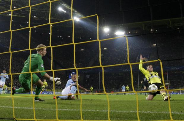 CRUCIAL GOAL: Joe Hart sees Julian Schieber score the winner as Manchester City lost 1-0 to Borussia Dortmund last night