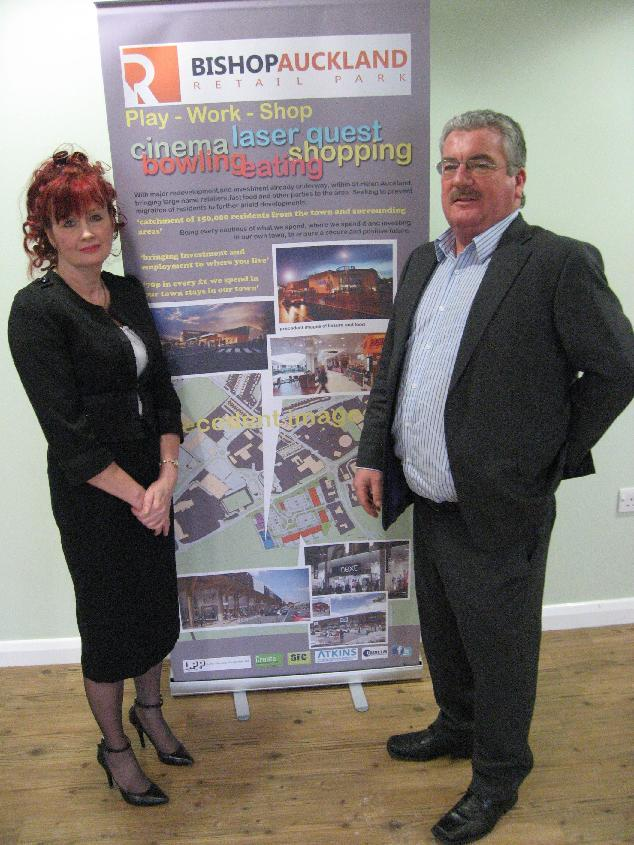 Maria Plews with John Goode from Land Planning Partnership look at the plans
