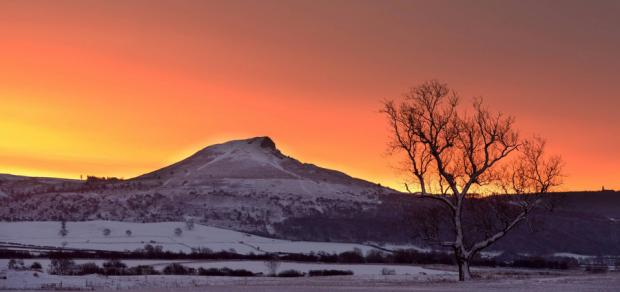 SNOW SUNRISE: A beautiful winter sunrise over Roseberry Topping, near Great Ayton, North Yorkshire, after the region woke to a blanket of snow