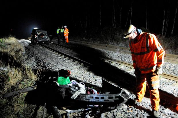 RAIL SMASH: Investigators at the scene of the collision