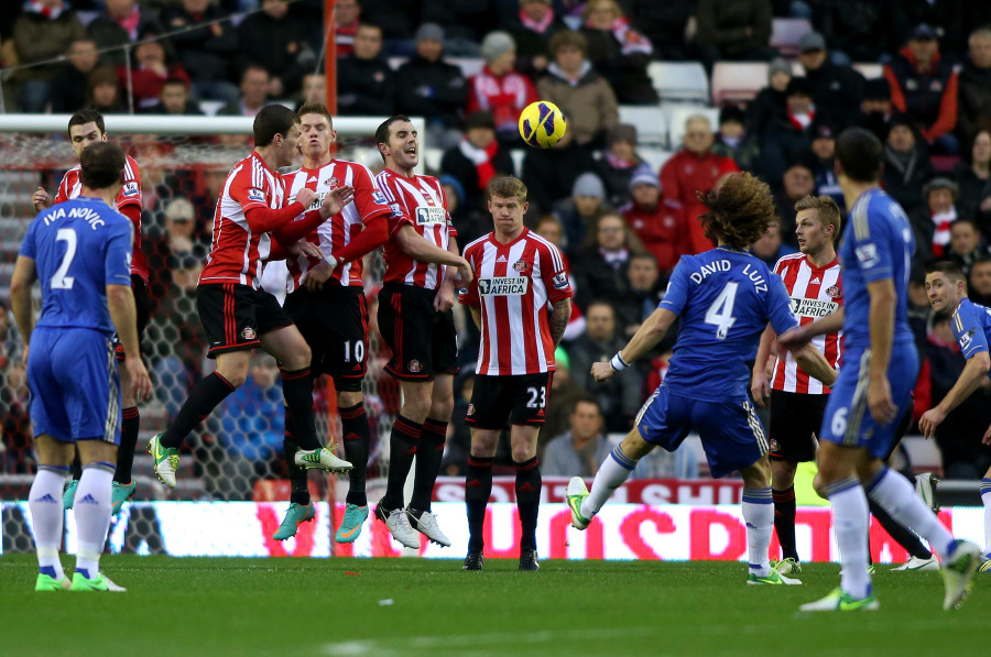 JUMP TO IT: Chelsea's David Luiz attempts to bend a free-kick around the Sunderland wall