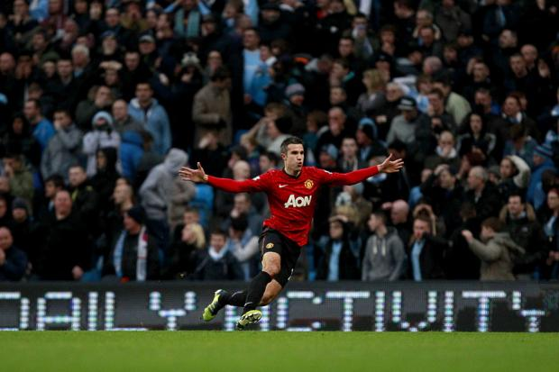 THE WINNER: Robin Van Persie celebrates his goal for Manchester United