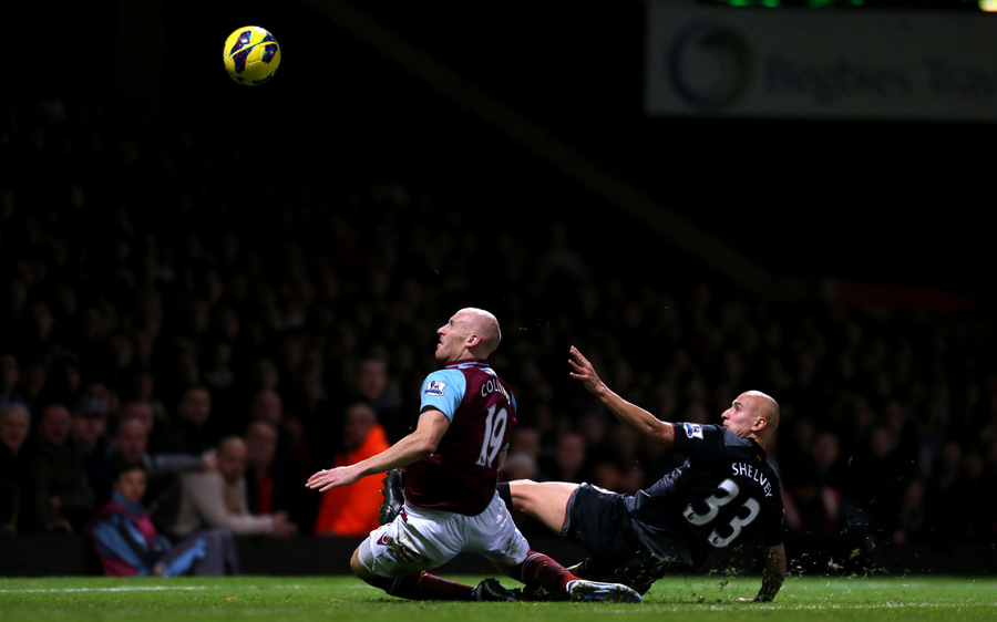 GOALBOUND: West Ham United's James Collins, left, deflects the ball into his own net for Liverpool's third goal under pressure from Liverpool's Jonjo Shelvey