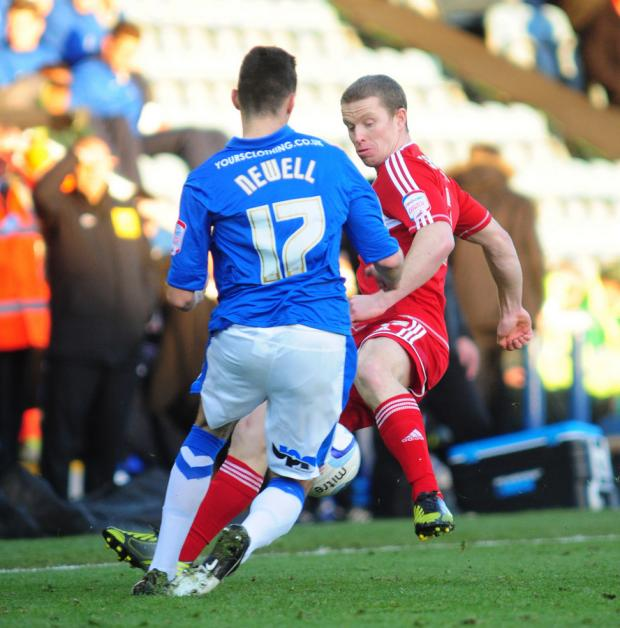 The Northern Echo: CLOSELY MARKED: Peterborough's Joe Newell is tackled by Grant Leadbitter