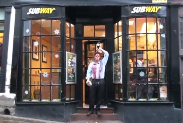 A student pours a bottle of port over his head outside Subway sandwich shop in Durham