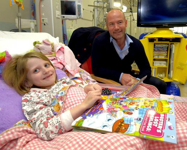 Alan Shearer with seven-year-old Sadie Merrin from Glasgow