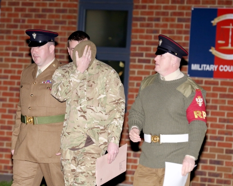 David Millican, centre, leaves Colchester Court martial centre after being sentenced