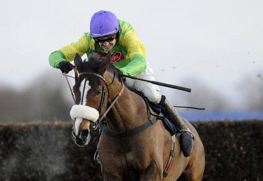 HAPPIER TIMES: Jockey Ruby Walsh with Kauto Star winning the King George VI Steeple Chase last year