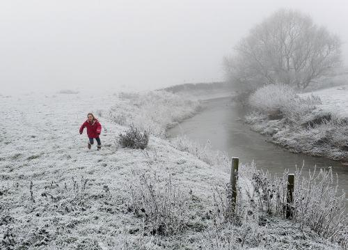 Emily Cowell, aged nine, runs along a frost covered path near Thirsk, North Yorkshire.