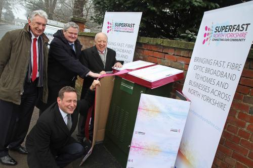 "The Northern Echo: Ed Vaizey ""unwrapping"" the superfast fibre broadband with (l-r) Coun Arthur Barker,Mike Galvin,of BT Openreach and Coun Carl Les,chairman of Superfast North Yorkshire"
