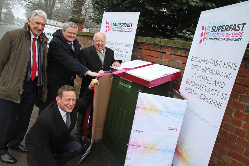 "TRIUMPH: Minister for Communications Ed Vaizey ""unwraps"" the superfast fibre broadband in Ainderby Steeple with, from left, Councillor Arthur Barker, Mike Galvin, head of network investment for BT Openreach, and Councillor Carl Les"