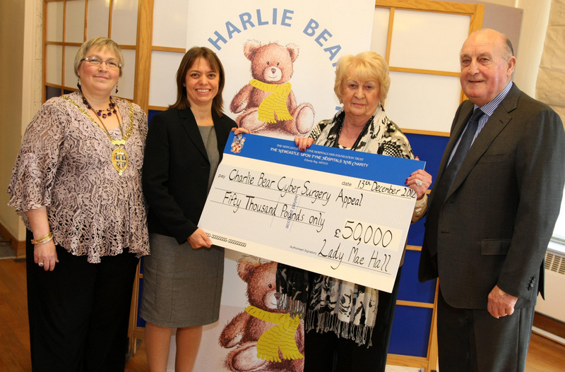 STARTING OUT: Lady Mae Hall hands a cheque for £50,000 from Sir John Hall, right, to Nicola Bruce, manager of cancer services at the Northern Centre for Cancer Care with, left, Linda Marshall, chairwoman of Durham County Council