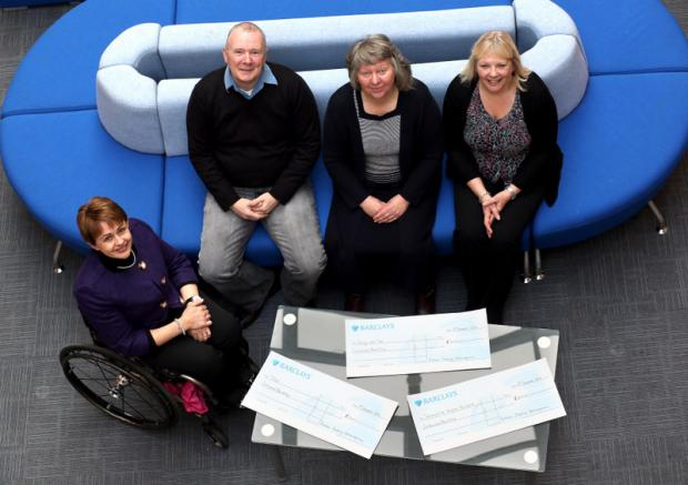 CHEQUE HAND-OVER: Baroness Tanni Grey-Thompson, left, hands cheques to, from left, Tom Carroll, of Fishing with Tom, Joan Bailey, of Teesdale Opportunities for Disabled Youngsters Association (Todys), and Sue Fox, from Willowburn Hospice, in Derwentside