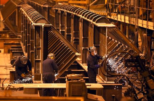 Welders at Cleveland Bridge work on a section of footbridge