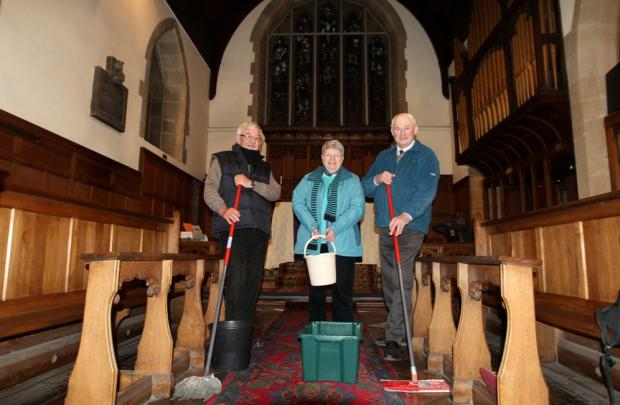 Church steward Lewis Bean, parishioner Anne Heywood and steward Robin Stevenson mopping up the mess
