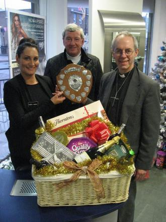 Pauline Smith accepts the shield and hamper from Clive Auld and the Bishop of Durham