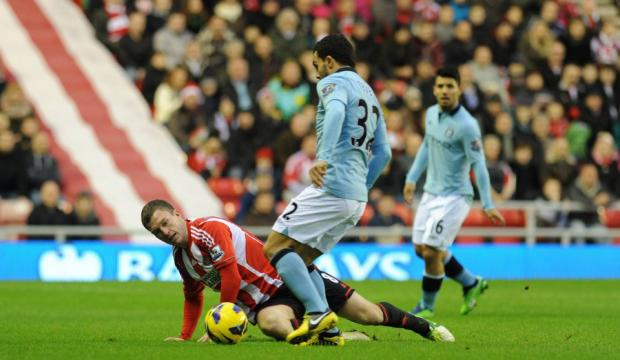 NO WAY THROUGH: Sunderland midfielder Craig Gardner makes sure Carlos Tevez can't get through
