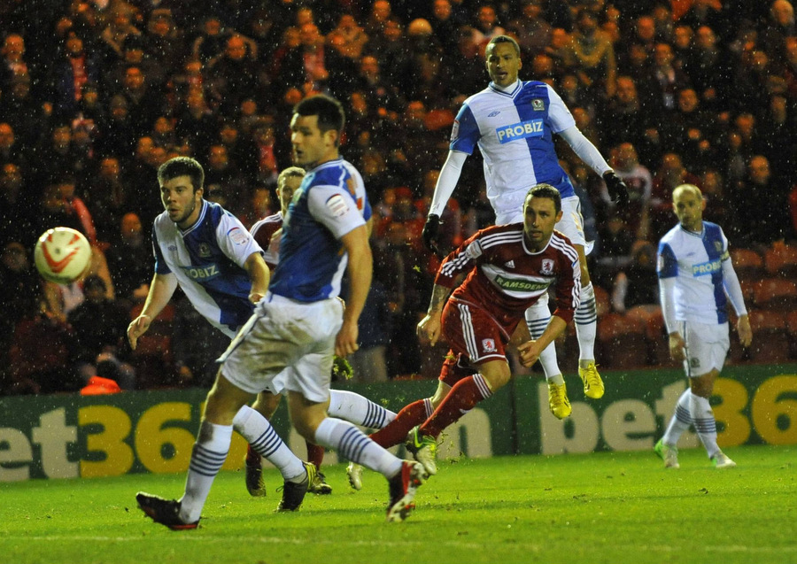 GONE BEGGING: Scott McDonald shoots wide while surrounded by Blackburn defenders