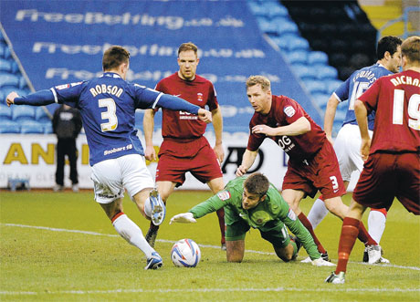 MAKING THE MOST OF IT: Matty Robson scores after goalkeeper Scott Flinders dropped the ball in the penalty area