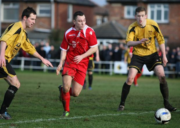 The Northern Echo: AWAY WIN: Nathan Thomas breaks through the Norton defence