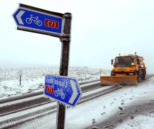 A snow plough clears the road near Nenthead, Cumbria, where wintry weather covered many parts of northern England this morning, Thursday. Forecasters are predicting that Britain will be hit by more wild weather over the next few days.