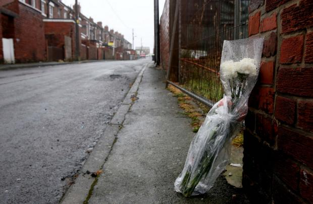 Flowers left at the scene in Stanley