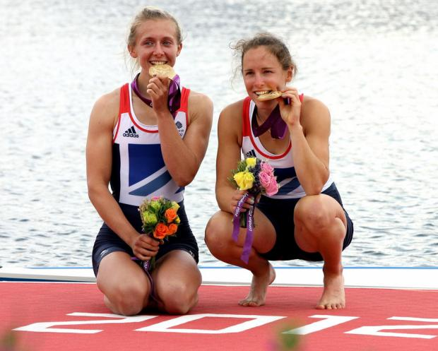 GOLDEN GIRL: Kat Copeland, left, and rowing partner Sophie Hosking after winning gold at London 2012