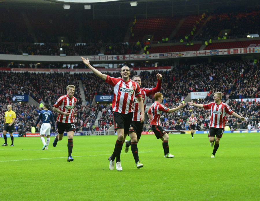 MISSING OUT: John O'Shea celebrates his first goal for Sunderland, but will miss out on Wednesday's game at Anfield