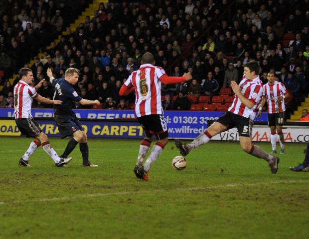 The Northern Echo: HOME FROM HOME: Pools' midfielder Ritchie Humphreys knocks in their second goal at Bramall Lane