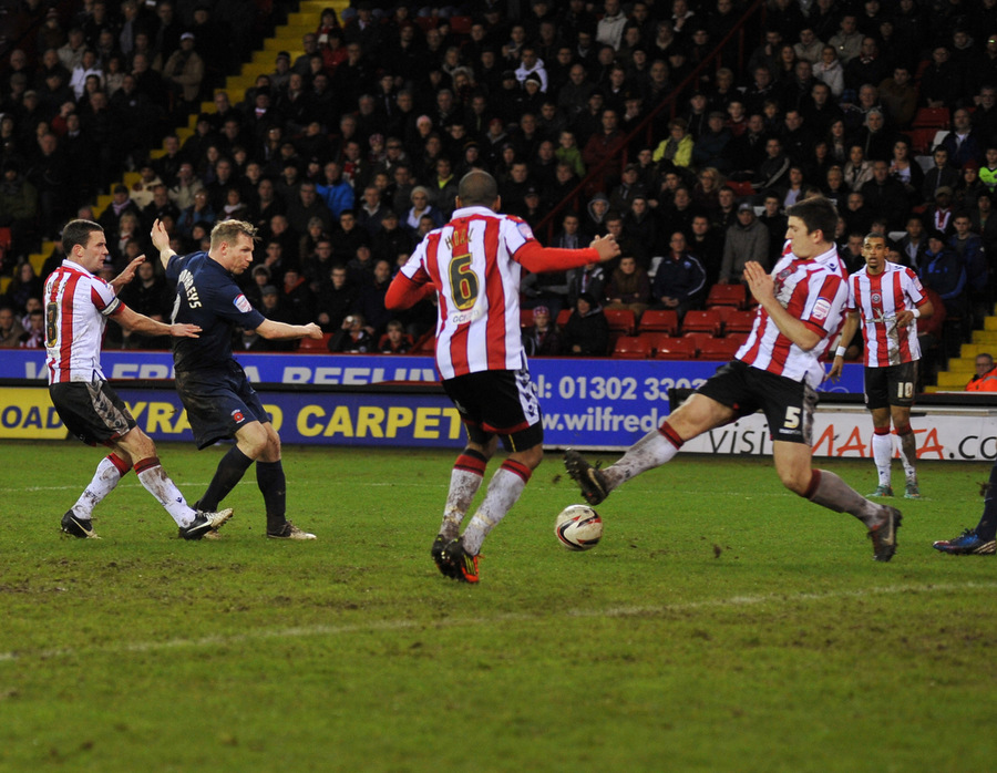 HOME FROM HOME: Pools' midfielder Ritchie Humphreys knocks in their second goal at Bramall Lane