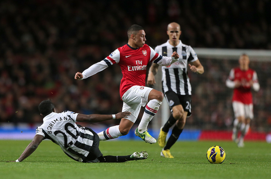 WORDS OF PRAISE: Arsenal's Alex Oxlade-Chamberlain skips over a challenge by United's Gael Bigirimana