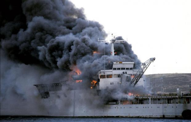 WORLD AT WAR: A 1982 picture of HMS Sir Galahad ablaze after an Argentine air raid at Bluff Cove near Fitzroy settlement on East Falkland