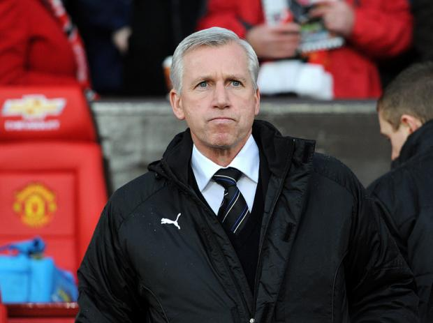 SPRING IN HIS STEP: Newcastle United manager Alan Pardew during the Barclays Premier League match at Old Trafford, Manchester
