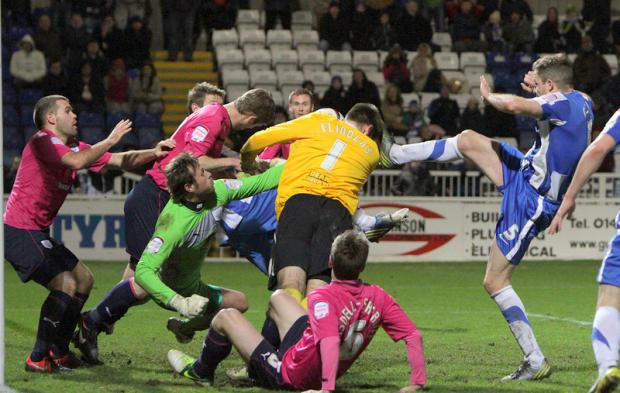 The Northern Echo: HEADS YOU LOSE: Hartlepool keeper Scott Flinders, up for a last minute corner, gets his head in where it hurts