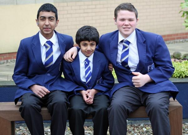 Shezan Khan (left) and Jordan Naylor with Waseem Hussain (centre), who they rescued from a swimming pool