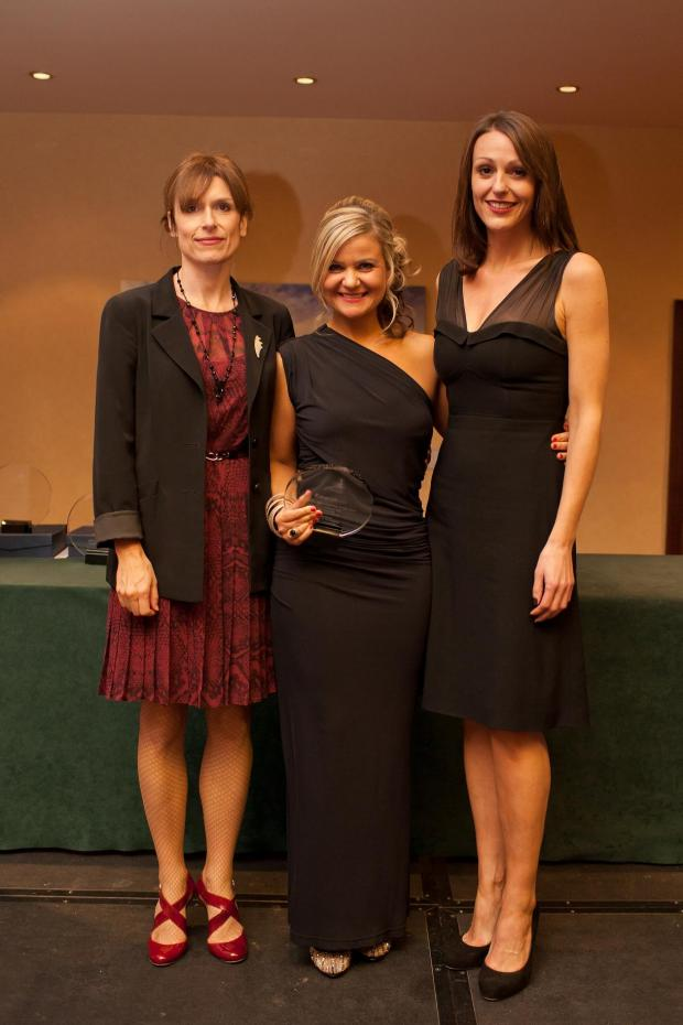 The Northern Echo: Detective Constable Claire Errington, centre, receives her award from actors Amelia Bullmore, left, and Suranne Jones, who play DCI