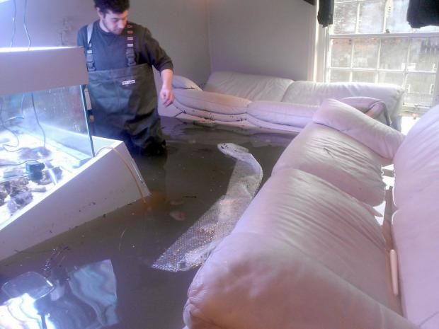 UNDER WATER: Nikki Hinds in his living room during one flood