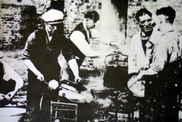 ICONIC IMAGE: Con Shiels Sr, far right, prepares a meal for marchers taking part in the Jarrow Crusade in 1936