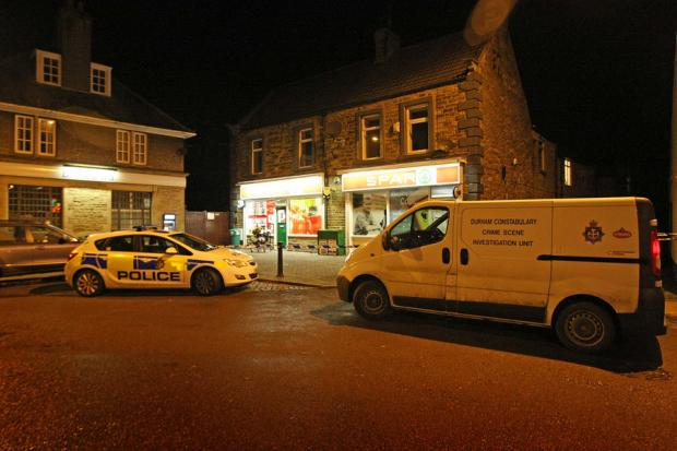 HUNT FOR CLUES: Investigators at the Spar store in Wolsingham following the robbery