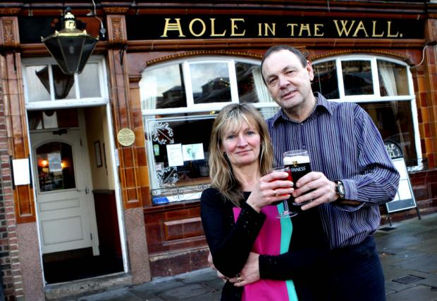 CALLING TIME: Phil and Mandy James outside the pub