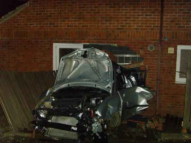 LUCKY ESCAPE: The wreckage of the car that crashed into the attached garage in Ferryhill Station